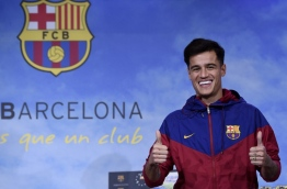 Coutinho is in Barcelona to tie up a 160-million-euro ($192 million) move from Liverpool, the third-richest deal of all time. / AFP PHOTO / Josep LAGO