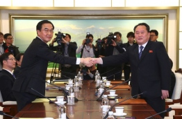 North and South Korea began their first official talks in more than two years on January 9, focussing on the forthcoming Winter Olympics after months of tensions over Pyongyang's nuclear weapons programme. / AFP PHOTO / KOREA POOL / KOREA POOL / South Korea OUT