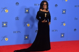 Actress and TV talk show host Oprah Winfrey poses with the Cecil B. DeMille Award during the 75th Golden Globe Awards on January 7, 2018, in Beverly Hills, California. / AFP PHOTO / Frederic J. BROWN