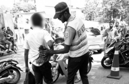 A police officer helps a student of Dharumavantha School was stabbed in Lily Magu, Male. PHOTO/SOCIAL MEDIA