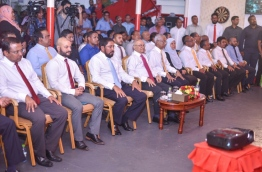 Qasim Ibrahim (L-3) with other opposition leaders at a joint opposition rally at Jumhoory Party's main hub. PHOTO/MIHAARU