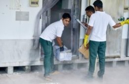 Sun Island Resort's staff take out stored products from the resort's cold storage. FILE PHOTO: NISHAN ALI/MIHAARU