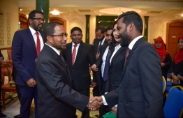 President of the Judges' Association Shuaib Hussain Zakariyya (L) shaking hands with attendees in a ceremony. PHOTO: NISHAN ALI/ MIHAARU