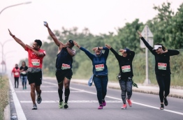 "Participants of TFG's ""Run in Laamu"" do the 'dab dance' as they run along Laamu atoll's scenic route. PHOTO/TFG"