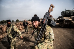 The operation aims to oust the People's Protection Units (YPG) militia, which Turkey considers to be a terror group, from its enclave of Afrin. / AFP PHOTO / BULENT KILIC