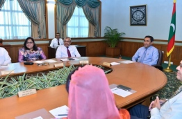 Minister of Legal Affairs of the President's Office, Azima Shakoor (L), pictured at a cabinet meeting with President Abdulla Yameen (R). PHOTO: NISHAN ALI/MIHAARU