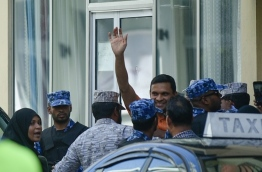 Former defence minister Mohamed Nazim escorted back to jail from house arrest on February 6, 2018. PHOTO: HUSSAIN WAHEED/MIHAARU