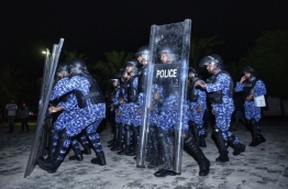 Riot police pictured in front of MDP's main hub in capital Male. PHOTO: HUSSAIN WAHEED/MIHAARU
