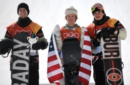 Silver medallist Canada's Max Parrot, gold medallist US Redmond Gerard and bronze medallist Canada's Mark McMorris celebrate during the victory ceremony at the end of the men's snowboard slopestyle final at the Phoenix Park during the Pyeongchang 2018 Winter Olympic Games on February 11, 2018 in Pyeongchang. / AFP PHOTO / Martin BUREAU
