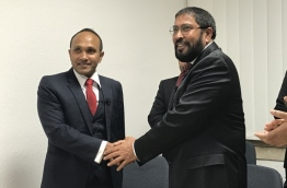 Former Vice President Dr Mohamed Jameel Ahmed (L) with Jumhoory Party's leader Qasim Ibrahim (R), after Dr Jameel joined the party in Frankfurt, Germany --