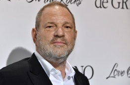 "The state of New York filed a lawsuit against Harvey Weinstein, his brother and their eponymous production company on February 11, 2018, for ""egregious violations"" of civil rights, human rights and business laws. / AFP PHOTO / Yann COATSALIOU"