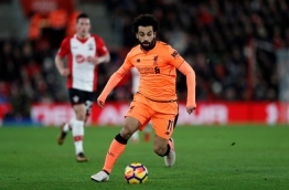 Liverpool's Egyptian midfielder Mohamed Salah runs with the ball during the English Premier League football match between Southampton and Liverpool at St Mary's Stadium in Southampton, southern England on February 11, 2018. / AFP PHOTO / Adrian DENNIS / RESTRICTED TO EDITORIAL USE. No use with unauthorized audio, video, data, fixture lists, club/league logos or 'live' services. Online in-match use limited to 75 images, no video emulation. No use in betting, games or single club/league/player publications. /