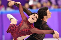 Canada's Tessa Virtue and Canada's Scott Moir compete in the figure skating team event ice dance free dance during the Pyeongchang 2018 Winter Olympic Games at the Gangneung Ice Arena in Gangneung on February 12, 2018. / AFP PHOTO / Mladen ANTONOV