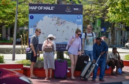 A group of tourists pictured outside the Republic Square in Male. PHOTO: HUSSAIN WAHEED/MIHAARU