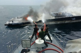 MNDF soldiers work to put out a fire on a boat near Reethi Beach Resort. PHOTO/MNDF
