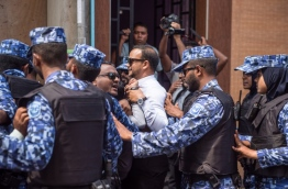 Police bar MP Hussain Ali from entering the parliament. PHOTO/MIHAARU/NISHAN ALI