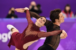 Canada's Tessa Virtue and Canada's Scott Moir compete in the ice dance free dance of the figure skating event during the Pyeongchang 2018 Winter Olympic Games at the Gangneung Ice Arena in Gangneung on February 20, 2018. / AFP PHOTO / Mladen ANTONOV