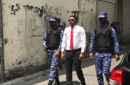 Galolhu South MP Ahmed Mahloof escorted away by the police.