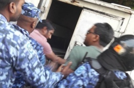 "MP Abdullah ""Abulhoa"" Mohamed being taken in the police jeep by the riot police on February 23, 2018. --"