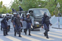 Police officers in riot gear in Hithadhoo, Addu City on February 23, 2018 --