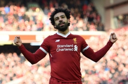 Liverpool's Egyptian midfielder Mohamed Salah celebrates scoring the team's second goal during the English Premier League football match between Liverpool and West Ham United at Anfield in Liverpool, north west England on February 24, 2018. / AFP PHOTO / Oli SCARFF / RESTRICTED TO EDITORIAL USE. No use with unauthorized audio, video, data, fixture lists, club/league logos or 'live' services. Online in-match use limited to 75 images, no video emulation. No use in betting, games or single club/league/player publications. /