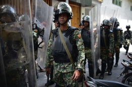 Military officers in riot gear dispatched to control political unrest in Male. PHOTO: NISHAN ALI/MIHAARU