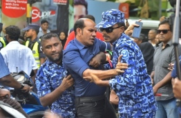 Police officers arrest Dhidhdhoo MP Abdul Latheef Mohamed at the joint opposition protest on March 2, 2018. PHOTO: HUSSAIN WAHEED/MIHAARU