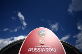 Restaurant staff are taking crash language courses and landlords are jacking up prices as the mostly Muslim capital of Russia's Olympic dreams prepares to host the World Cup. / AFP PHOTO / FRANCK FIFE