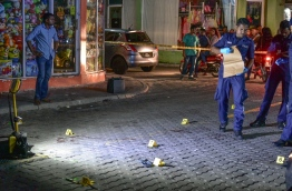 Police officers at the crime scene. PHOTO/MIHAARU