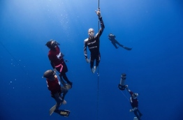 William Trubridge pictured during a free dive, with other divers accompanying him.