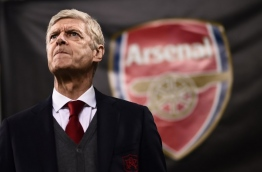 Arsenal's coach Arsene Wenger from France looks on during the UEFA Europa League round of 16 first-leg football match AC Milan Vs Arsenal at the 'San Siro Stadium' in Milan on March 8, 2018. / AFP PHOTO / MARCO BERTORELLO