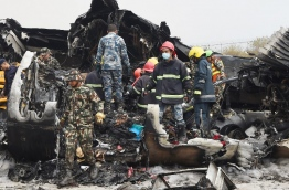 At least 40 people were killed and 23 injured when a Bangladeshi plane crashed and burst into flames near Kathmandu airport on March 12, in the worst aviation disaster to hit Nepal in years. Officials said there were 71 people on board the US-Bangla Airlines plane from Dhaka when it crashed into a football field near the airport. / AFP PHOTO / PRAKASH MATHEMA