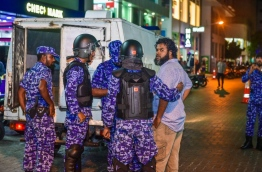 A protester being escorted to the police vehicle . PHOTO/ NISHAN ALI/ MIHAARU