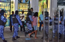 Police officers in riot gear arrest a protester during the opposition rally on March 16, 2018. PHOTO: NISHAN ALI/MIHAARU