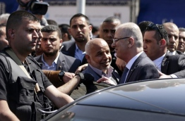 Palestinian president Mahmud Abbas directly accused Hamas on March 19, 2018 of carrying out a bomb attack against prime minister Rami Hamdallah in Gaza last week, threatening fresh sanctions against them. / AFP PHOTO / MAHMUD HAMS