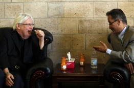 The newly appointed Umited Nations envoy to Yemen, Martin Griffiths (L), listens to the under-secretary of Huthi-led government's foreign ministry, Faisal Amin Abu-Rass upon his arrival at Sanaa airport in Sanaa, on March 24, 2018. / AFP PHOTO / MOHAMMED HUWAIS