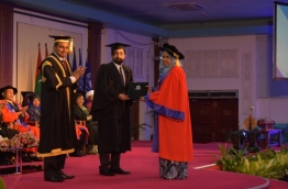 The student receiving a PhD from MNU --