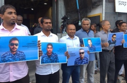 Members and supporters of MDP during a rally, holding posters of the police officers that were arrested after the Supreme Court's ruling on February 1, 2018.