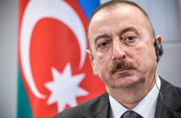 Azerbaijan President Ilham Aliyev is set to secure a fourth consecutive term on on April 11, 2018 in snap polls boycotted by the oil-rich nation's main opposition parties. Aliyev, 56, was first elected president in 2003, after the death of his father Heydar Aliyev, a former KGB officer and communist-era leader who had ruled Azerbaijan with an iron fist since 1993. / AFP PHOTO / Ilmars ZNOTINS / TO GO WITH AFP STORY BY Elman Mamedov