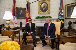 The Emir of Qatar Sheikh Tamim bin Hamad al-Thani speaks to the press with US President Donald Trump in the Oval Office at the White House in Washington, DC, on April 10, 2018. / AFP PHOTO / NICHOLAS KAMM
