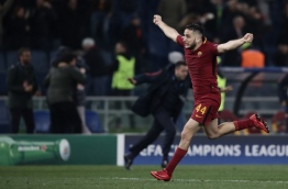 AS Roma's Greek defender Kostas Manolas celebrates after winning the UEFA Champions League quarter-final second leg football match between AS Roma and FC Barcelona at the Olympic Stadium in Rome on April 10, 2018. / AFP PHOTO / Isabella BONOTTO