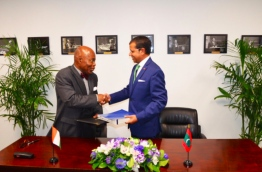 The The Permanent Representative of Maldives to the UN, Dr Ali Naseer (R) and the The Permanent Representative of Côte d'Ivoire Bernard Tanoh-Boutchoue (L) signing the joint communiqué in New York --