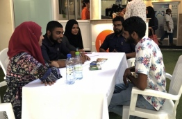 A patient consulting the the doctors at the Smoking Cessation Clinic at the state-run Indhira Gandhi Memorial Hospital (IGMH) --