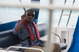 Former CP Ahmed Areef in a police launch to be taken to Dhoonidhoo after his arrest on March 6, 2018. MIHAARU PHOTO / HUSSEN WAHEED