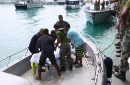 The body of Ahmed Mohamed, 37, who went missing after a speedboat accident on April 19, 2018, brought to Male in a Coast Guard vessel. PHOTO/MNDF