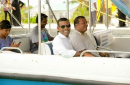 Former President Mohamed Nasheed pictured with the Hithadhoo-North MP Ahmed Aslam during the presidential election campaign in 2013 --
