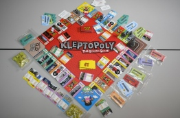 """Kleptopoly"", a Malaysian board game based on ""Monopoly"", is poking fun at a massive financial scandal ahead of elections, featuring a motley crew of figures central to the controversy and items allegedly bought with looted money. / AFP PHOTO / Mohd RASFAN / TO GO WITH Malaysia-politics-corruption-game"