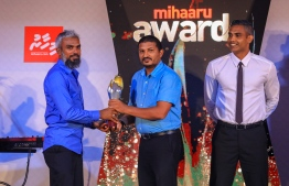 "Paradise Island Resort, May 5, 2018: Ismail ""Kuda Kaattey"" Sajid won Best Volleyball Player. He was unable to attend the ceremony and the award was accepted in his stead by his brother, Mohamed ""Bodu Kaattey"" Sajid (L), the coach of the men's national volleyball team. PHOTO/IMAGES.MV"