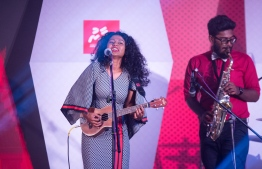 "Paradise Island Resort, May 5, 2018: Detune Band's guitarist and lead female vocalist, Fathimath ""Fezu"" Fezleen"", performs at the Mihaaru Awards. PHOTO/IMAGES.MV"