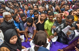 People gathered inside the Housing Ministry to pick up application forms for the social housing scheme 'Hiyaa Project'. PHOTO: NISHAN ALI/MIHAARU